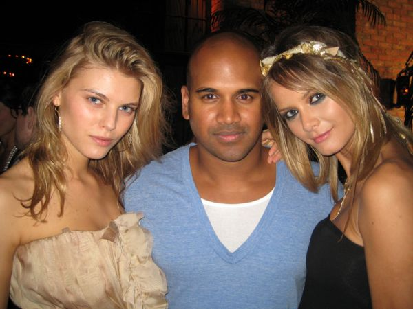 Maryna Linchuk and Flavia Oliveira surround Kannon