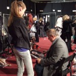 Backstage at Marc by Marc, Fabien Baron checks out the portfolio of Monica, also known as Jac
