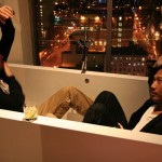 Kelly Rippy and agent Greg Chan clown around in the tub overlooking NYC