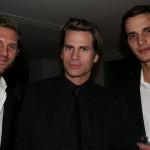 Modeling stars RJ and David Smith congratulate Mark