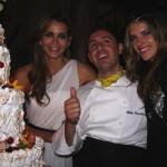 Fernanda and Alessandra surround the chef