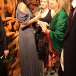 Patricia in Carlos Miele greeting her guests.