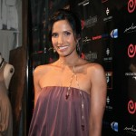 Padma in vintage Halston is wearing pieces from her jewelry line, at Padmalakshmi.com