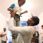 Salieu has fun with Cy, one of NY's youngest art fans.
