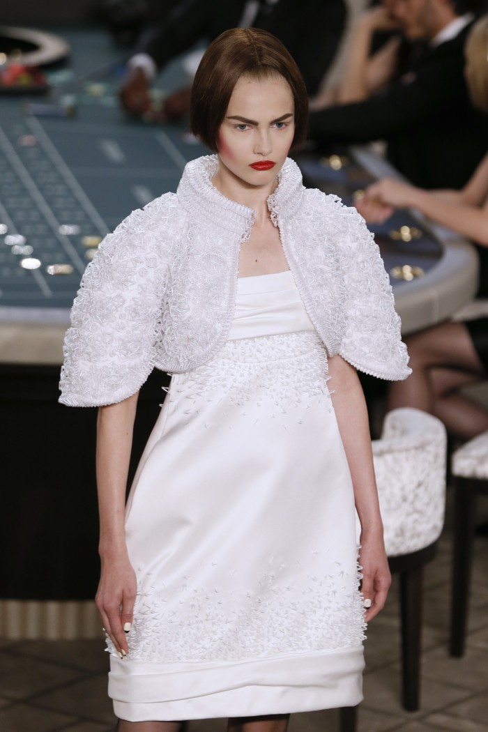 A model presents a creation for Chanel during the 2015-2016 fall/winter Haute Couture collection fashion show on July 7, 2015 at the Grand Palais in Paris.            AFP PHOTO / PATRICK KOVARIK        (Photo credit should read PATRICK KOVARIK/AFP/Getty Images)
