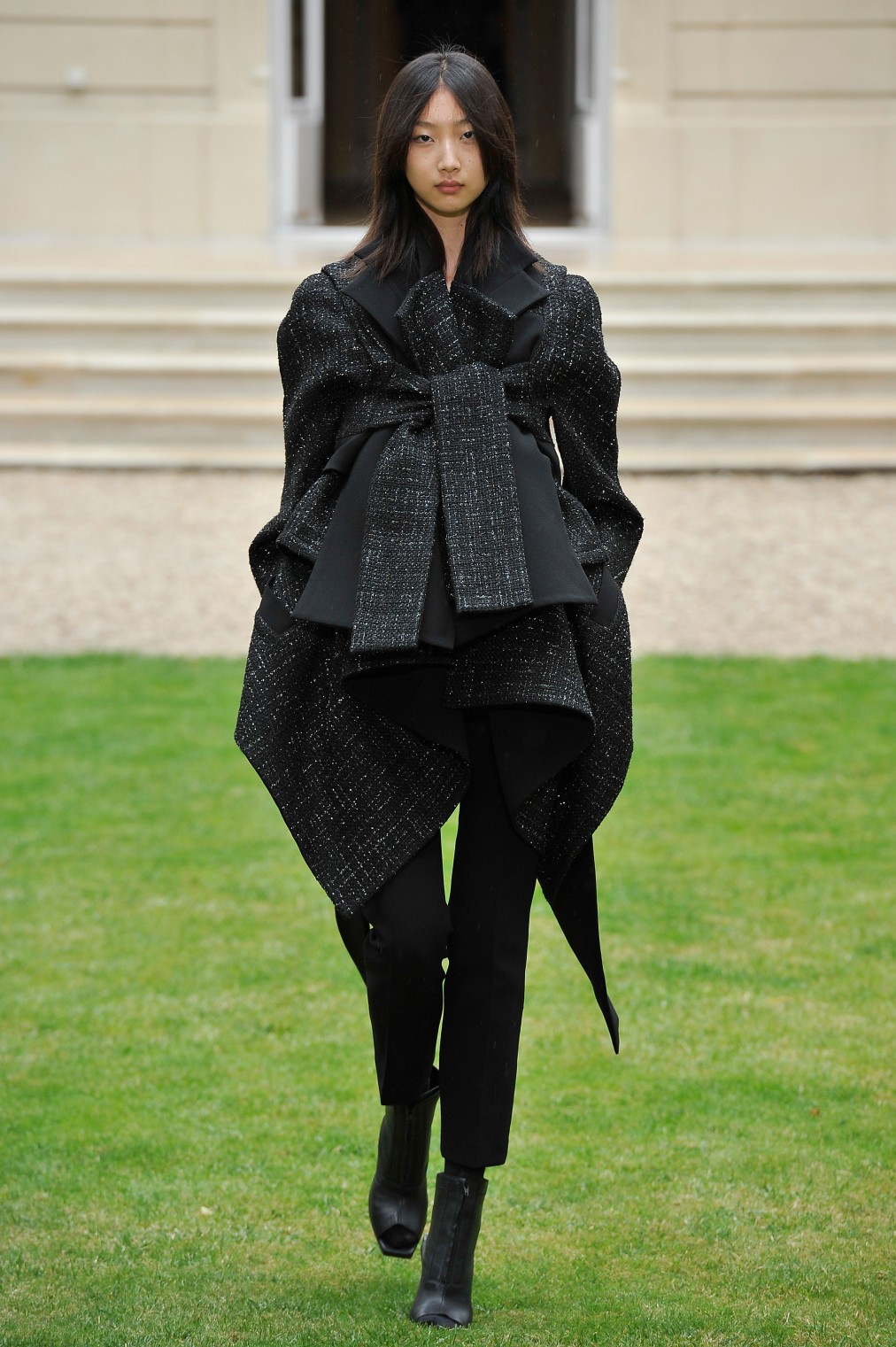 PARIS, FRANCE - JULY 09:  A model walks the runway during the Rad Hourani show as part of Paris Fashion Week - Haute Couture Fall/Winter 2014-2015 at the residence of the Canadian Ambassador to France on July 9, 2014 in Paris, France.  (Photo by Kristy Sparow/Getty Images)