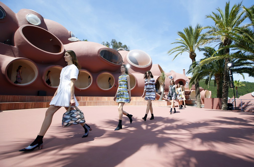 Models present creations by Belgian fashion designer Raf Simons during the Dior 2016 cruise collection show, on May 11, 2015 at the Palais Bulle in Theoule-sur-Mer, southeastern France.  AFP PHOTO / VALERY HACHE        (Photo credit should read VALERY HACHE/AFP/Getty Images)