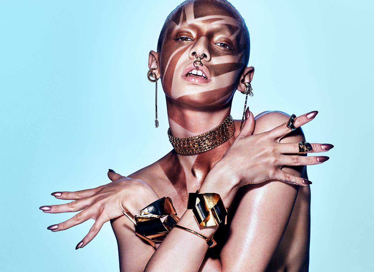 Chain Ear Cuff – Laruicci  Ear Cuff & Nose Ring – Chrishabana  Long Gold  Earring – Eddie Borgo  Choker – Erickson Beamon  Cuff Bracelets & Rings –  Oblik